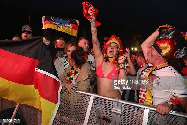 Fans celebrate Germany's first goal at a public viewing in front of the Brandenburg Gate while watching the Germany vs Italy quarterfinals 2016 UEFA...