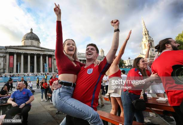 Fans celebrate Harry Kane's first goal as England fans watch the euro 2020 quarter final match between England and Ukraine from inside the Fan Zone...