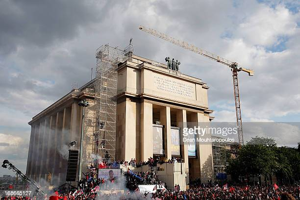 PSG fans celebrate in front of Musee d'Ethnographie du Trocadero or Ethnographic Museum of the Trocadero with flares and fireworks after winning...