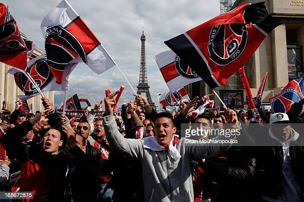 Fans celebrate in front of Musee d'Ethnographie du Trocadero or Ethnographic Museum of the Trocadero with flares and fireworks after winning Ligue 1...