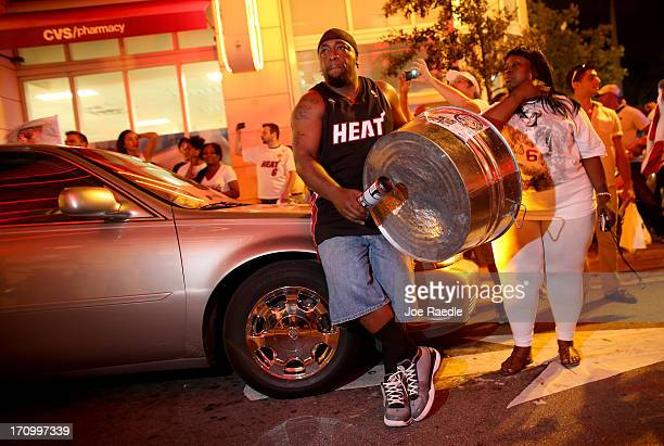 Fans celebrate in the streets after the Miami Heat won the NBA title against the San Antonio Spurs on June 20 2013 in Miami Florida The Heat have won...