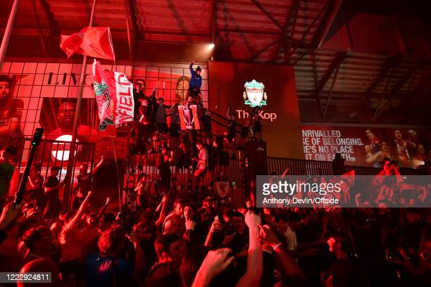Fans celebrate Liverpool becoming Premier League Champions outside Anfield on June 25, 2020 in Liverpool, England.