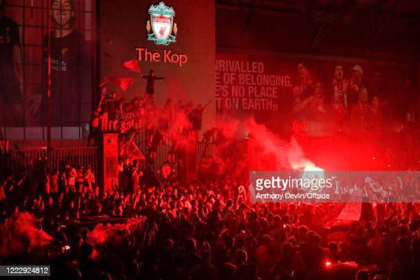 Fans celebrate Liverpool becoming Premier League Champions outside Anfield on June 25 2020 in Liverpool England