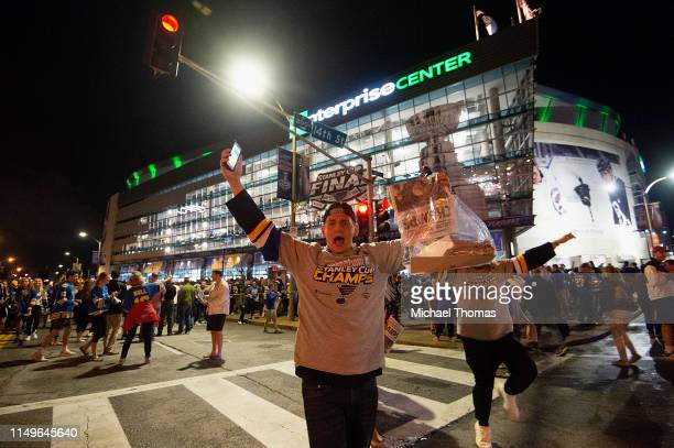 Fans celebrate outside the Stanley Cup Final Game 7 Watch Party between the Boston Bruins and the St. Louis Blues at the Enterprise Center on June...