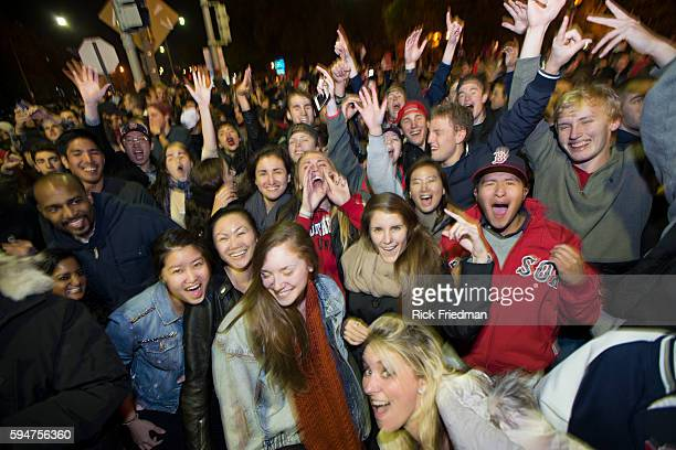 Fans celebrate the Boston Red Sox winning the World Series just outside Fenway Park in Boston MA on October 30 2013