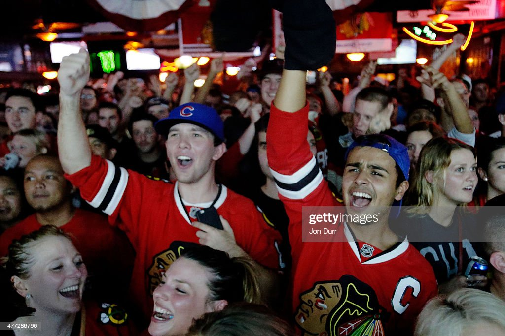 Fans celebrate the Chicago Blackhawks winning the 2015 Stanley Cup at Sluggers World Class Sports Bar on June 15, 2015 in Chicago, Illinois. The Blackhawks beat the Lightning 2 - 0 to win the Stanley Cup.