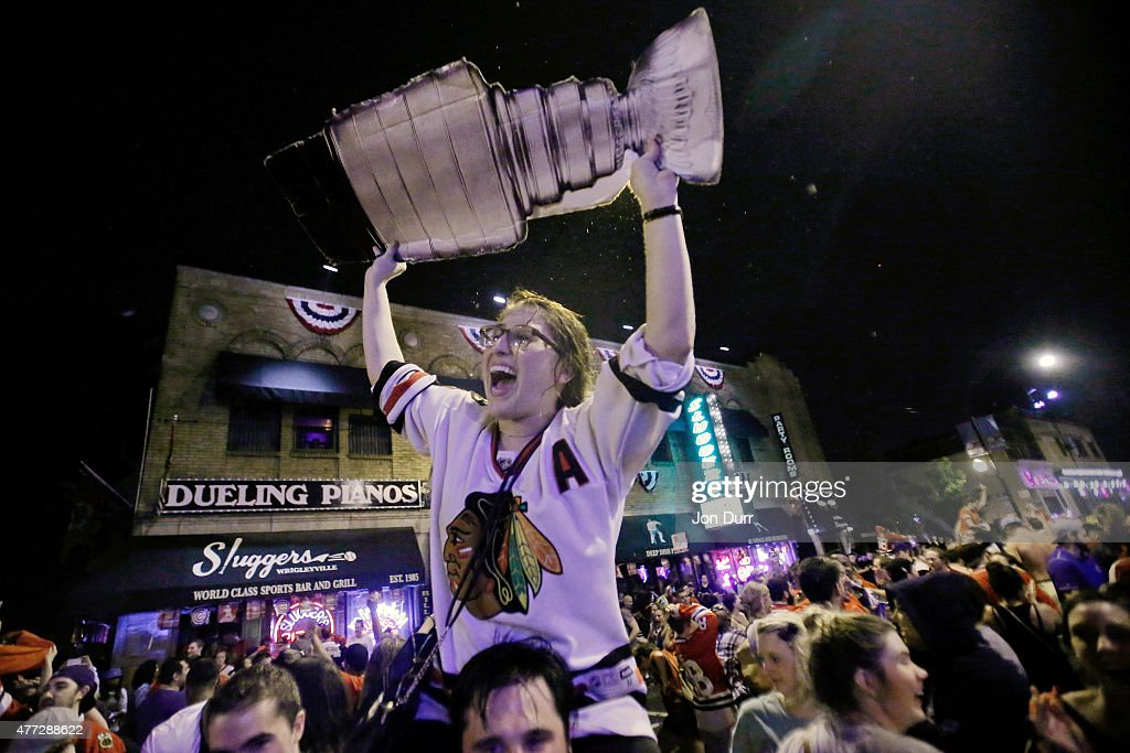 Fans celebrate the Chicago Blackhawks winning the 2015 Stanley Cup in front of at Sluggers World Class Sports Bar on June 15, 2015 in Chicago, Illinois. The Blackhawks beat the Lightning 2 - 0 to win the Stanley Cup.