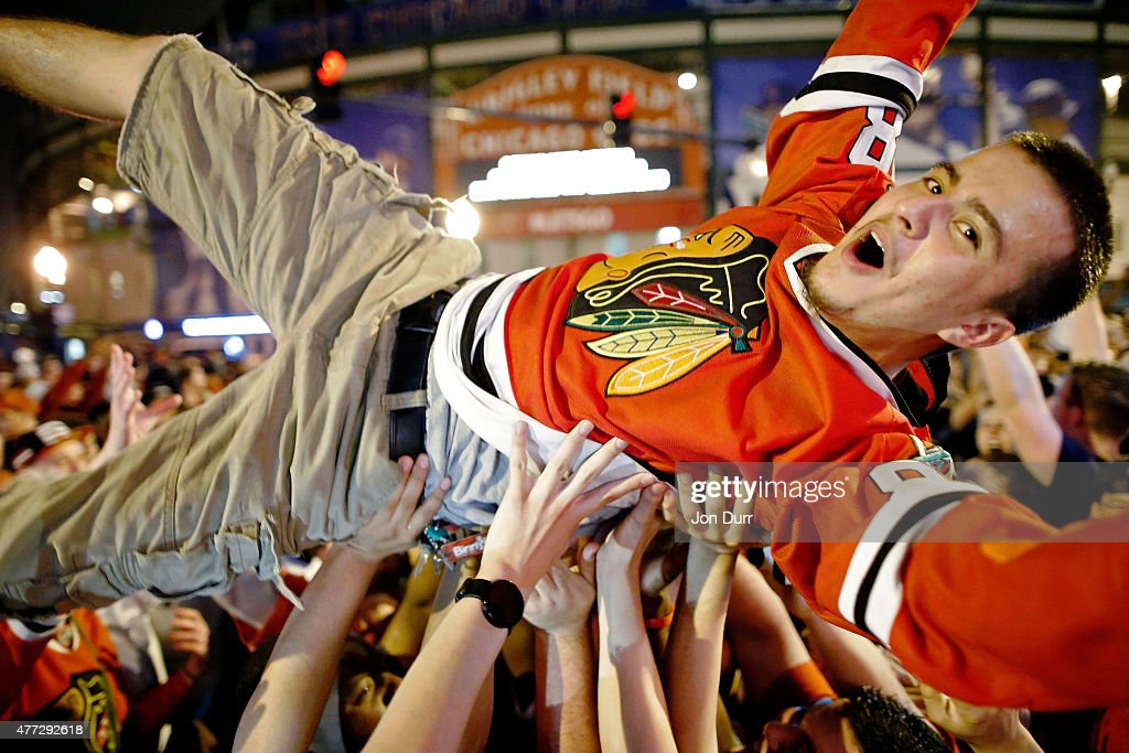 Fans celebrate the Chicago Blackhawks winning the 2015 Stanley Cup outside of Wrigley Field on June 15, 2015 in Chicago, Illinois.