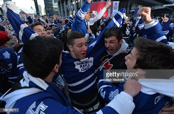 Fans celebrate the Leafs 2nd goal in 2nd period action in Maple Leaf Square Toronto Maple Leaf fans react to the Game 7 action in Boston between...