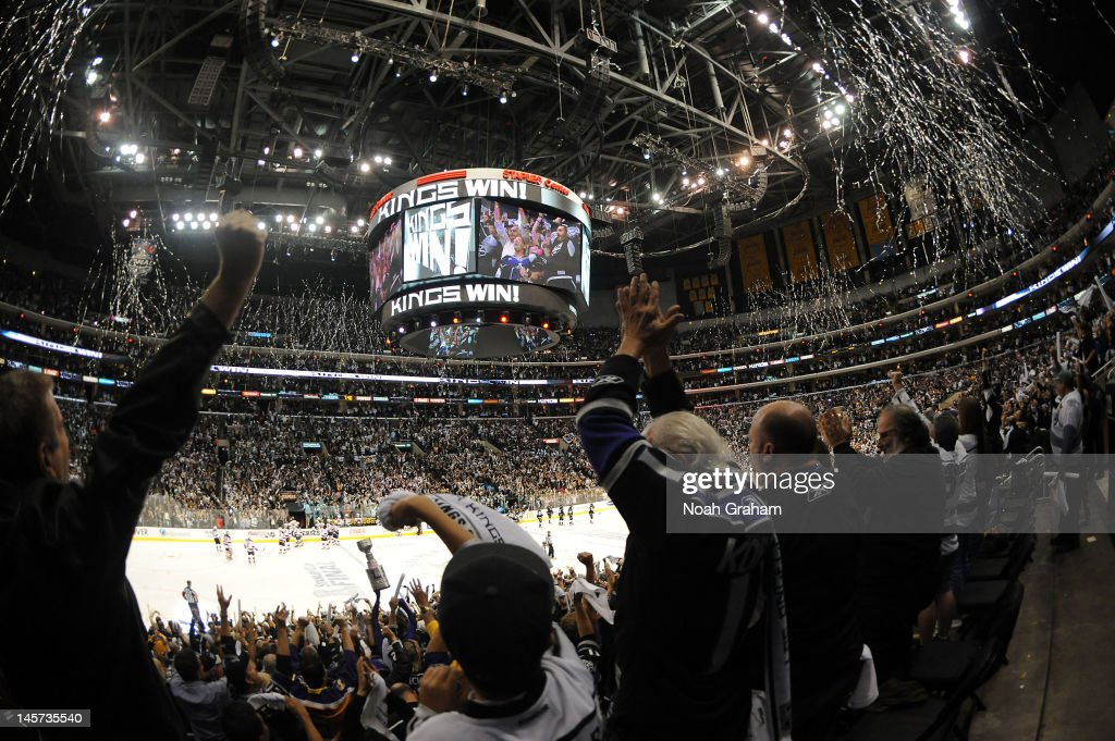 Fans celebrate the Los Angeles Kings victory against the New Jersey Devils in Game Three of the 2012 Stanley Cup Final at Staples Center on June 4, 2012 in Los Angeles, California.