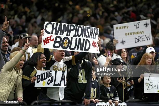 Fans celebrate the New Orleans Saints win over the Philadelphia Eagles in the NFC Divisional Playoff Game at Mercedes Benz Superdome on January 13...