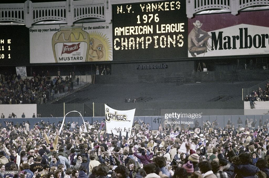 Fans celebrate the New York Yankees victory over the Kansas City Royals in the fifth game of the American League Championship Series on October 14, 1976 at Yankee Stadium in New York, New York. The Yankees will represent the American League in the World Series for the first time since 1964. 76-01801