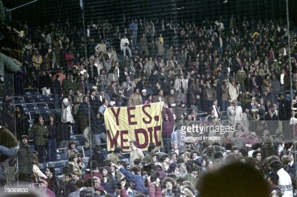 Fans celebrate the New York Yankees victory over the Kansas City Royals in the fifth game of the American League Championship Series on October 14...