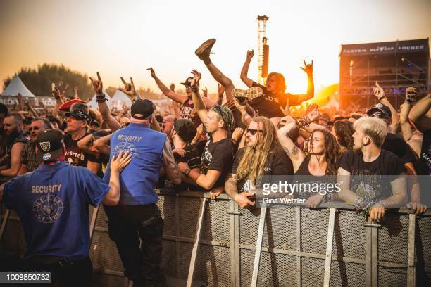 Fans celebrate the performance oh the American band Hatebreed during the Wacken Open Air festival on August 2 2018 in Wacken Germany Wacken is a...