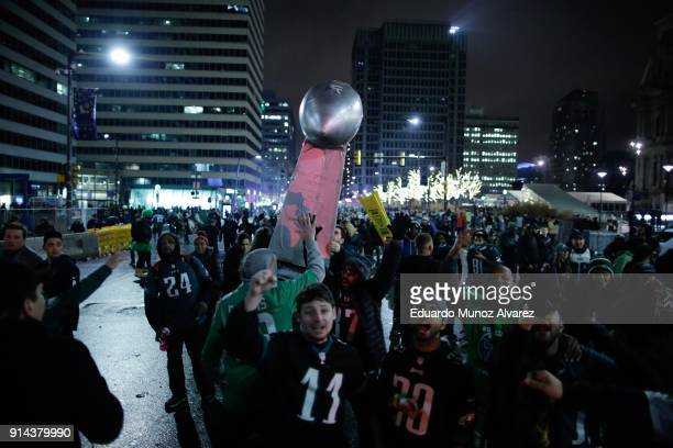 Fans celebrate the Philadelphia Eagles' victory in Super Bowl LII game against the New England Patriots on February 5 2018 in Philadelphia...