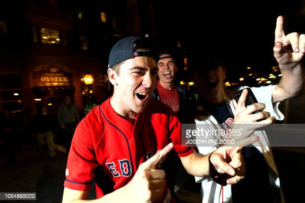 Fans celebrate the Red Sox World Series victory over the LA Dodgers at Kenmore Square in Boston Massachusetts late on October 28 2018 The Boston Red...