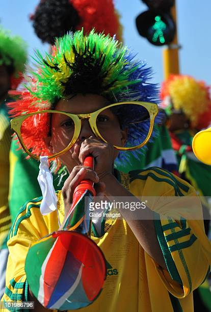 Fans celebrate the start of the 2010 World Cup June 11 2010 in Johannesburg South Africa