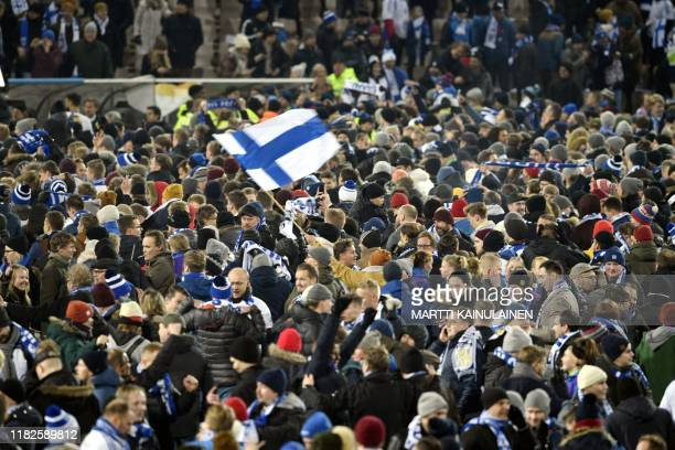 Fans celebrate the victory after the UEFA Euro 2020 Group J qualification football match between Finland and Liechtenstein in Helsinki, Finland, on...