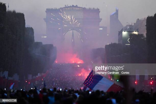 Fans celebrate the Victory of France in the World Cup 2018 on the Champs Elysees on July 15 2018 in Paris France