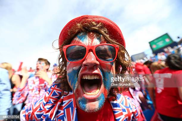 Fans celebrate the win between Jamie Murray and Andy Murray of Great Britain against Nicolas Mahut and JoWilfried Tsonga of France during Day Two of...