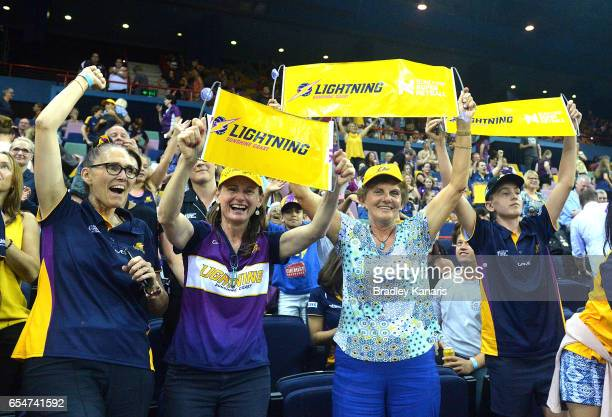 Fans celebrate their teams victory after the round five Super Netball match between the Lightning and the Magpies at Brisbane Entertainment Centre on...
