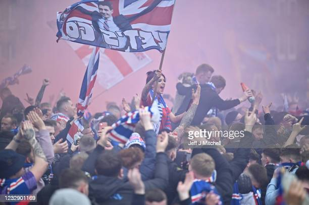 Fans celebrate winning the Scottish Premiership title outside the Ibrox Stadium on May 15, 2021 in Glasgow, Scotland. Rangers have won their first...