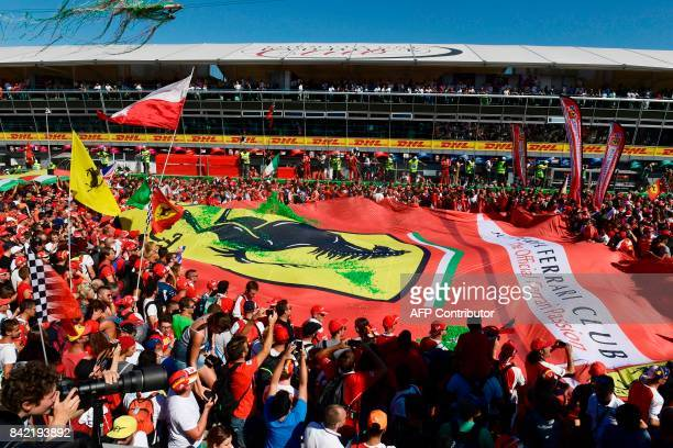 Fans celebrate with a giant banner showing the Scuderia Ferrari logo after the Italian Formula One Grand Prix at the Autodromo Nazionale circuit in...