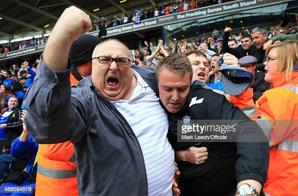 Fans celebrate with Birmingham manager Lee Clark after avoiding relegation following the Sky Bet Championship match between Bolton Wanderers and...
