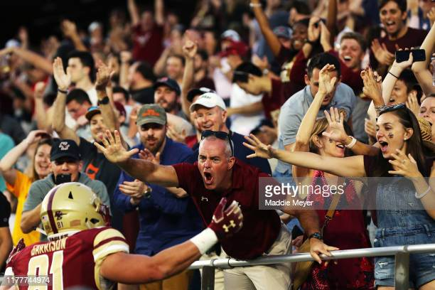 Fans celebrate with Chris Garrison of the Boston College Eagles after he scored a touchdown during the second half of the game between the Boston...