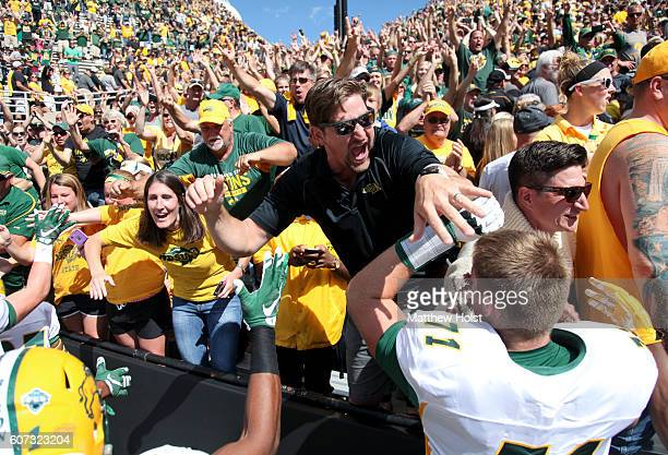 Fans celebrate with cornerback Darren Kelley of the North Dakota State Bisons after the upset over the Iowa Hawkeyes on September 17 2016 at Kinnick...