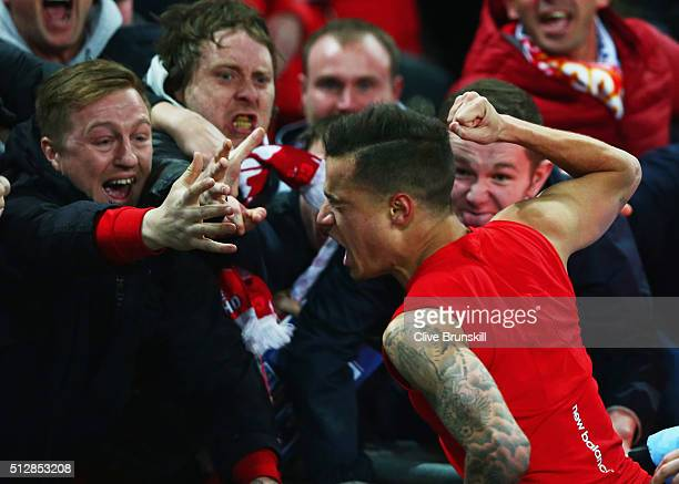 Fans celebrate with goalscorer Philippe Coutinho of Liverpool as he scores their first and equalising goal during the Capital One Cup Final match...