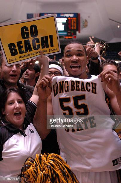 Fans celebrate with guard Aaron Nixon of the Long Beach State 49ers after a 94 to 83 win over the Cal Poly Mustangs in the championship game of the...
