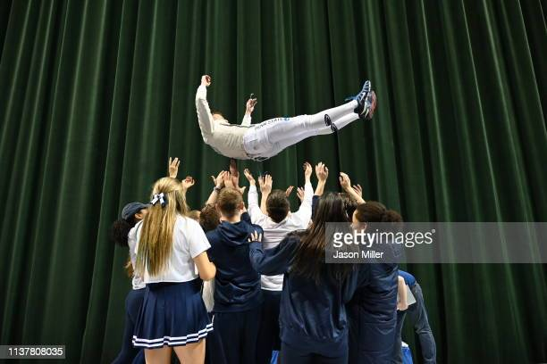 Fans celebrate with Men's Saber national champion Karol Metryka of Pen State during the Division I Men's Fencing Championship held at The Wolstein...