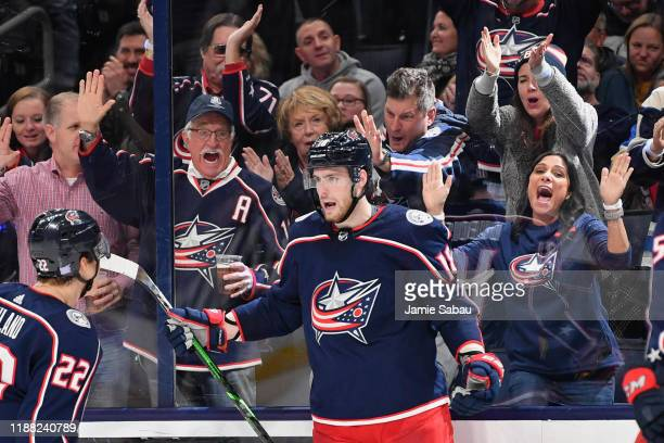 Fans celebrate with Pierre-Luc Dubois of the Columbus Blue Jackets after Dubois scored a goal against the St. Louis Blues on November 15, 2019 at...
