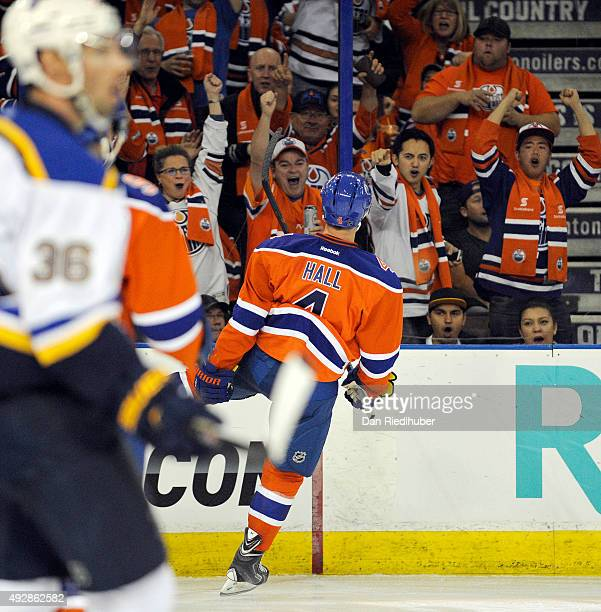 Fans celebrate with Taylor Hall of the Edmonton Oilers after he scored against the St Louis Blues at Rexall Place on October 15 2015 in Edmonton...