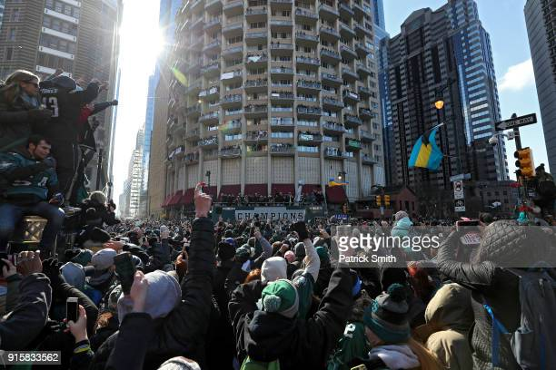 Fans celebrate with the Philadelphia Eagles during their NFL Super Bowl victory parade on February 8, 2018 in Philadelphia, Pennsylvania. The...