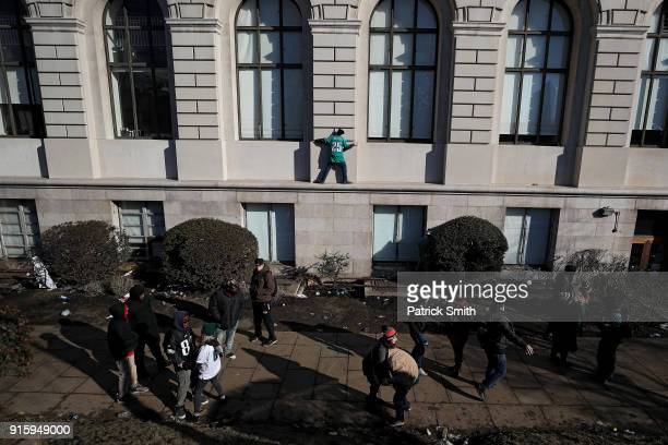 Fans celebrate with the Philadelphia Eagles during their NFL Super Bowl victory parade on February 8 2018 in Philadelphia Pennsylvania The...
