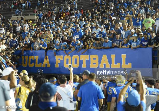 UCLA fans celebrate with the team as they return to the locker room through the tunner during a college football game between the Texas AM Aggies and...