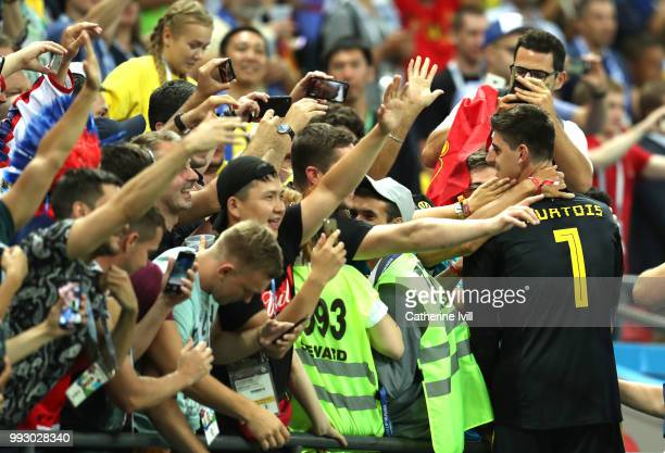 Fans celebrate with Thibaut Courtois of Belgium following the 2018 FIFA World Cup Russia Quarter Final match between Brazil and Belgium at Kazan...