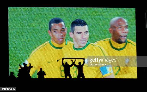 Fans celebrates in front of a big screen showing Brazilian players Gilberto Silva Lucio and Maicon after the 2010 FIFA World Cup Round of Sixteen...