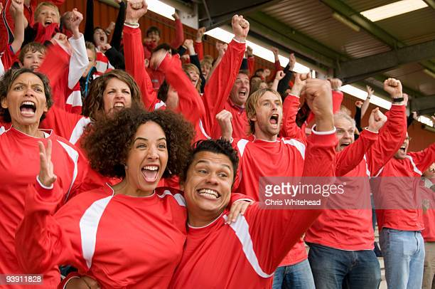 fans celebrating at at football match - spectator stock pictures, royalty-free photos & images