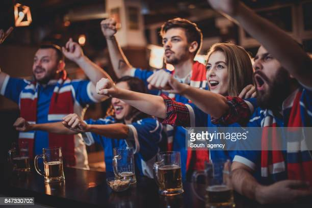 Fans celebrating at the bar