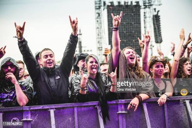 Fans celebrating the performance of a band at the Wacken Open Air festival on August 2 2018 in Wacken Germany Wacken is a village in northern Germany...
