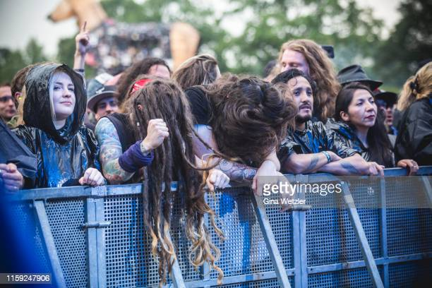 Fans celebrating the performance of a band at the Wacken Open Air festival on August 2, 2018 in Wacken, Germany. Wacken is a village in northern...