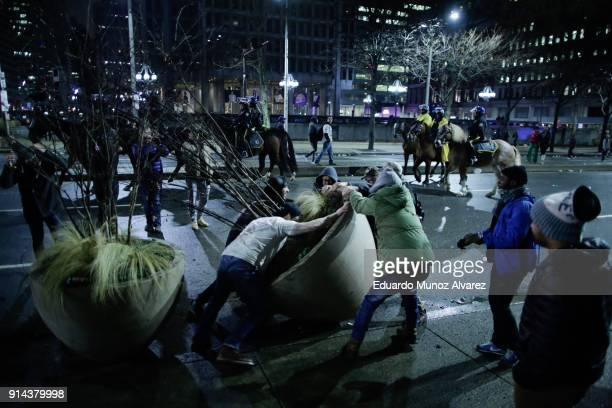 Fans celebrating the Philadelphia Eagles' victory in Super Bowl LII game against the New England Patriots on February 5 2018 in Philadelphia...