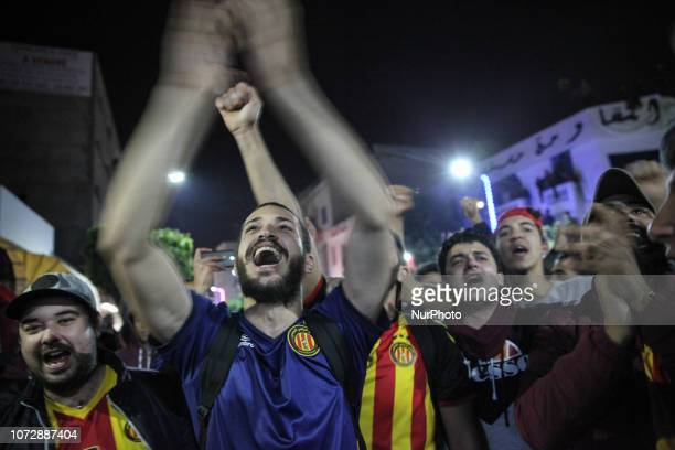 Fans chant songs as they attend the celebrations of the 100th anniversary of the Tunisian soccer club Espérance Sportive de Tunis held in Ariana...