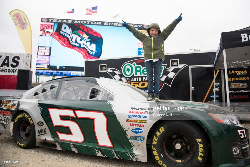 Fans check out the O'Reilly Auto Parts car before watching the Daytona 500 on the world's largest TV, Big Hoss, at Texas Motor Speedway on February 26, 2017 in Fort Worth, Texas.