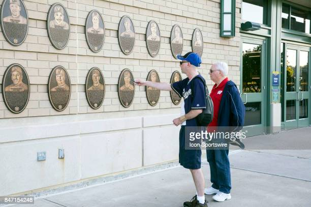 Fans checking out the Brewer's Wall of Fame outside Miller Park prior to the rubber match of the final home series between the Milwaukee Brewers and...