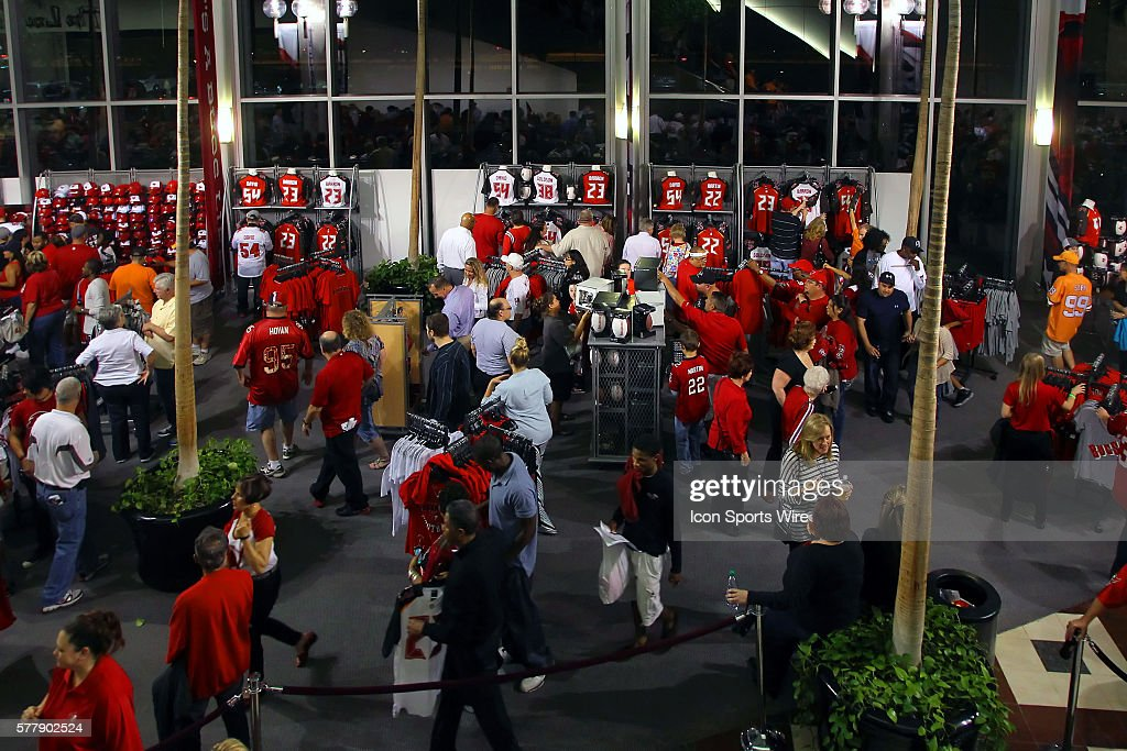 Nfl mar 28 tampa bay buccaneers uniform showcase pictures getty fans checking out the newest items for sale in the gift shop during the tampa bay negle Images