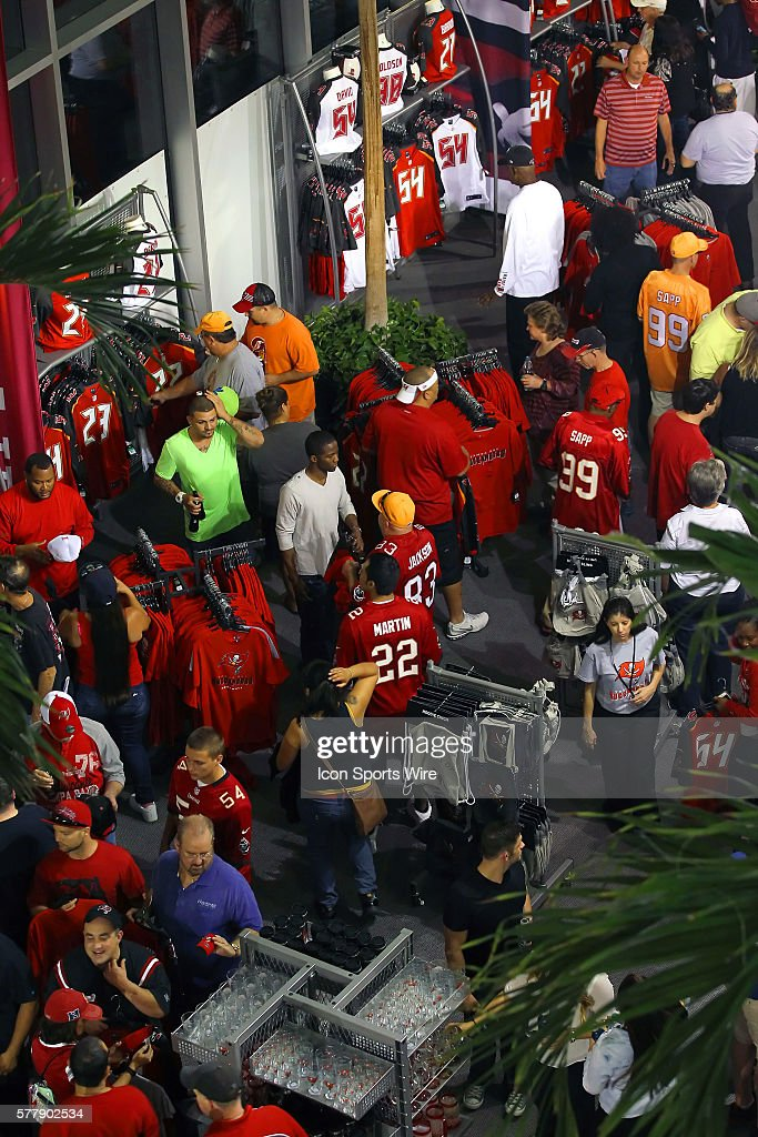Nfl mar 28 tampa bay buccaneers uniform showcase pictures getty fans checking out the newest items for sale in the gift shop during the tampa bay negle Choice Image